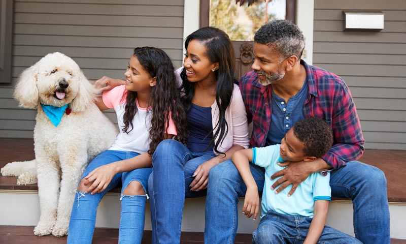 Family with Dog on steps
